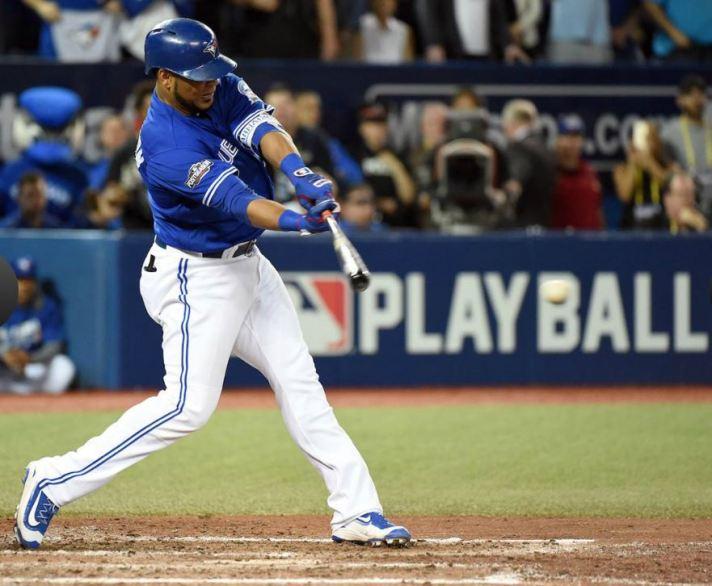 Edwin Encarnacion rips a two-run single in the seventh inning.  JON BLACKER/MLB PHOTOS