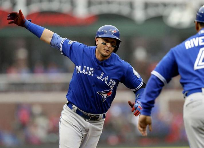 Troy Tulowitzki celebrates his two-run home run with third-base coach Luis Rivera in the second inning. LM OTERO/AP